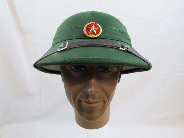 Vietcong tropical helmet with leather strap and badge from Filmfundus