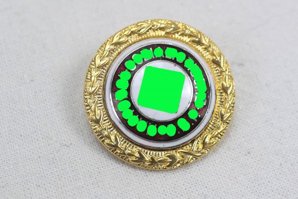 Miniature party badge in gold member badge of the NS party on pin