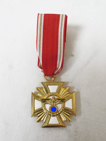 """Service Award of Party III Level in Gold """" Loyalty to leader and people """"."""