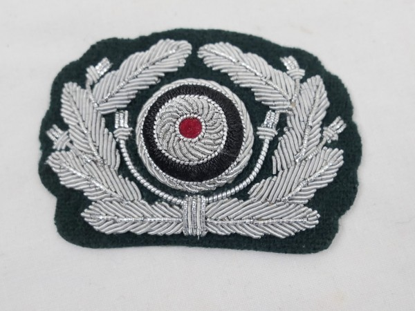 Effects oak leaf wreath with red cockade Wehrmacht peaked cap officer on M36 base Army